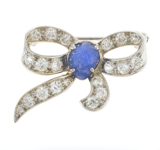 An art deco sapphire, diamond and platinum bow brooch