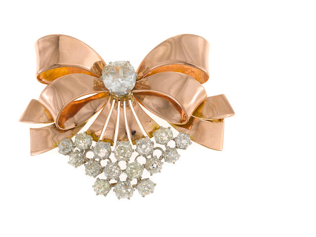 A cluster of 16 old mine cut diamond and bicolor gold bow brooch; estimated total diamond weight: 1.80cts.