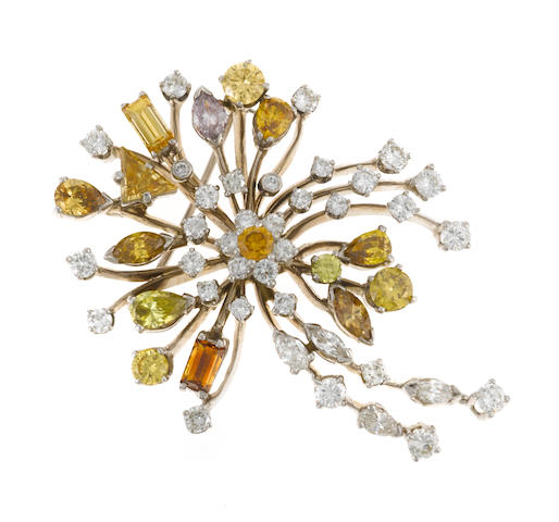 A multi-colored diamond brooch