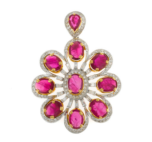 A ruby, diamond and bicolor gold pendant