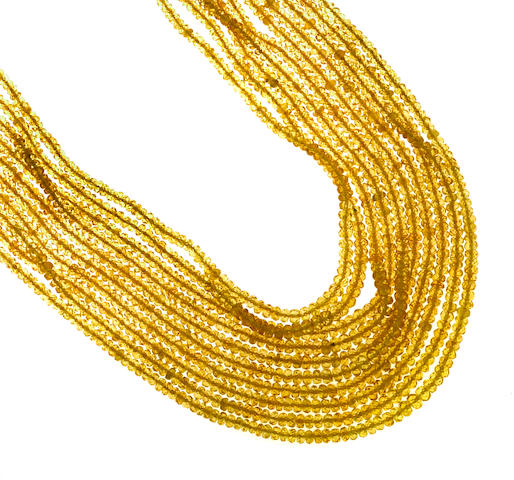 A yellow sapphire bead multi-strand necklace