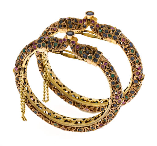 A pair of gem-set Mogul style bangle bracelets