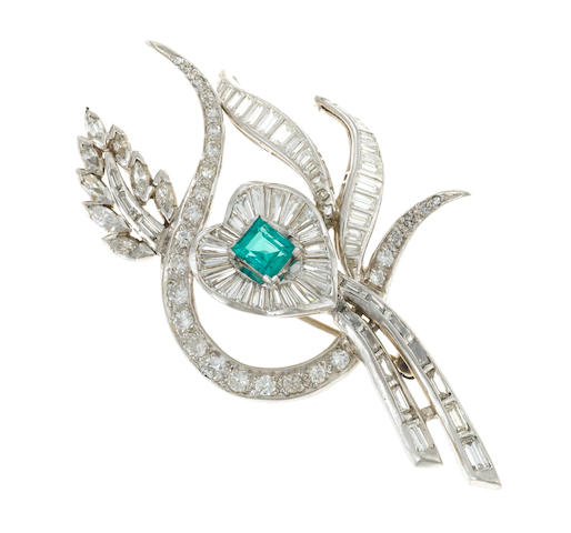 A diamond and synthetic emerald pendant/brooch