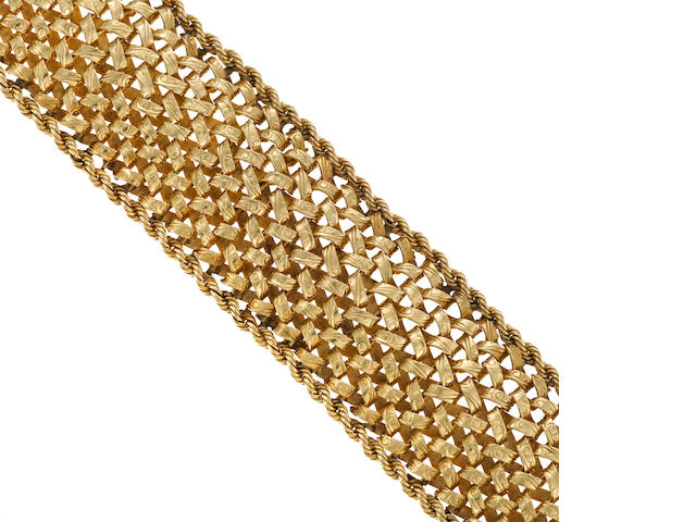 A fourteen karat gold wide woven style bracelet
