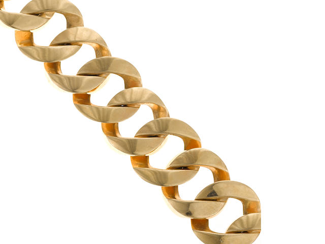 A fourteen karat gold wide curb-link bracelet