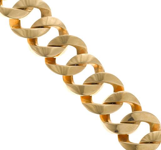 A fourteen karat gold wide curb-link bracelet