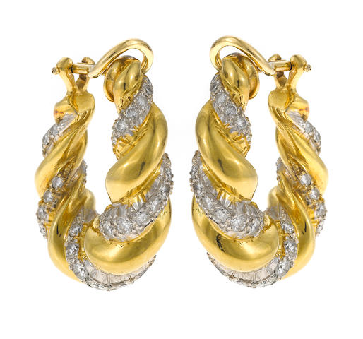 A pair of diamond and eighteen karat gold hoop earclips