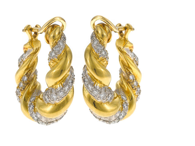 A pair of 18k gold and diamond twisted hoop earrings