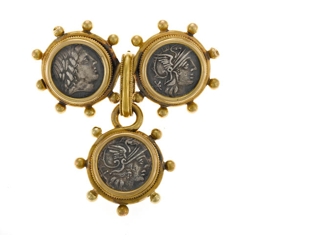 A metal coin and eighteen karat gold brooch and pendant/enhancer set