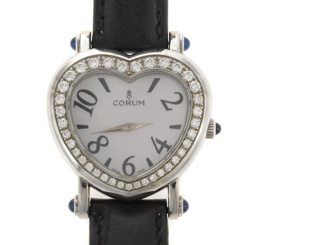 A Corum watch with diamonds, heart-shaped face