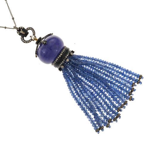 A tanzanite, sapphire, diamond and black onyx tassel pendant/necklace