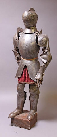 A miniature full suit of armor in 16th century style