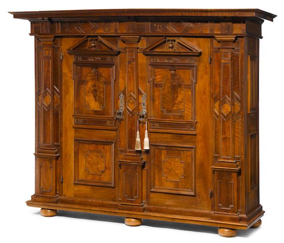 A Continental Baroque carved and inlaid walnut cabinet <BR />first half 18th century