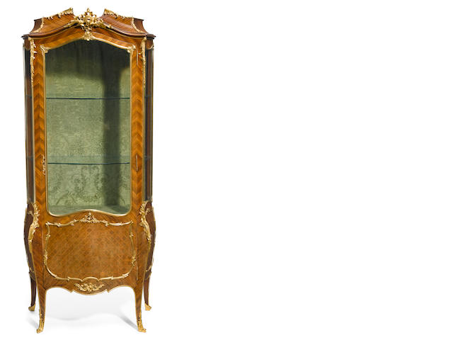 A Louis XV style gilt bronze mounted marquetry inlaid kingwood vitrine cabinet <BR />late 19th/early 20th century