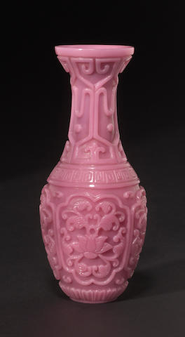 A carved rose glass vase imitating the patterns of Ming laquer bearing a Qianlong mark