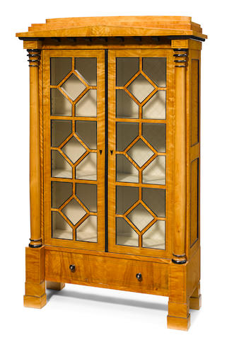 A Biedermeier parcel-ebonized satinwood vitrine cabinet, with Rupert Cavendish, London
