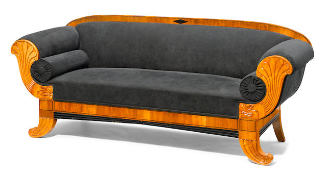 A suite of Biedermeier parcel ebonized walnut and satinwood seat furniture; a settee and a pair of bergeres
