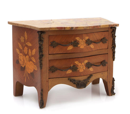 A Louis XV style inlaid walnut miniature commode