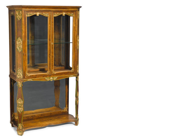 A French gilt bronze mounted mixed wood vitrine