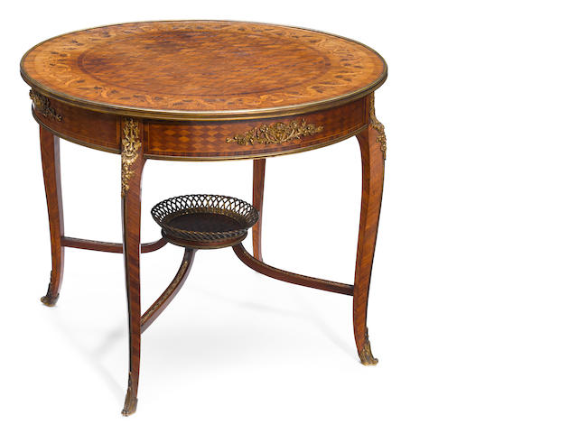 A Louis XV style gilt bronze mounted marquetry and parquetry center table