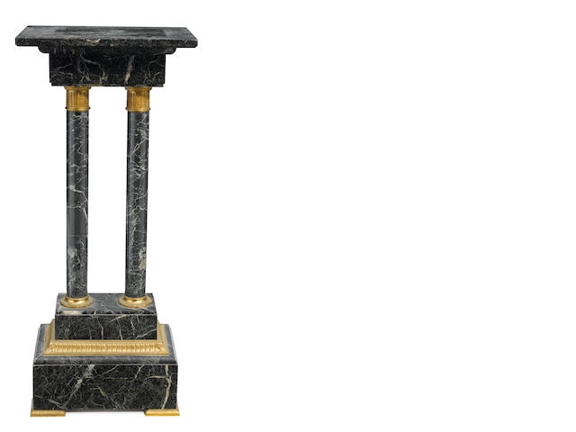 A French gilt bronze mounted marble pedestal with revolving top