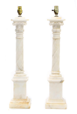 A pair of Neoclassical style carved alabaster column form lamps