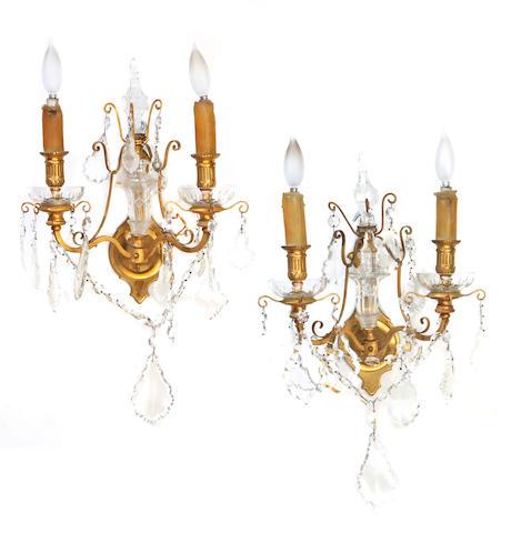 A pair of Louis XVI style gilt bronze and cut glass bras de lumière