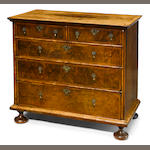 A William and Mary feather banded walnut chest