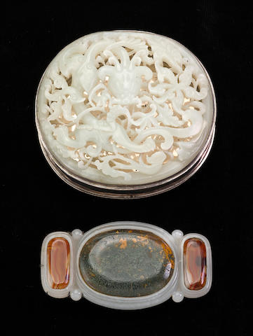 Two jade carvings, one jade belt buckle inset with agates, the other a reticulated jade plaque a mounted as the cover of a sterling silver cosmetic box