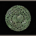 A reticulated spinach jade circular pendant with peach design