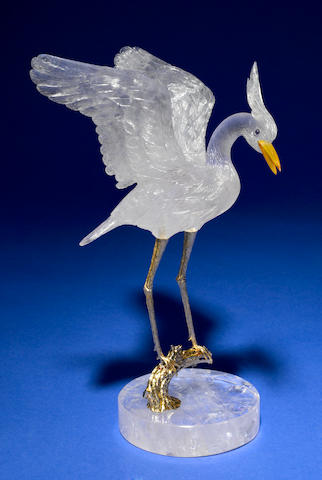 Stork, rock crystal on silver, gold plated branch on rock crystal base.