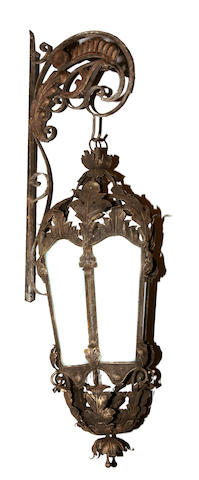 A pair of Victorian style wrought iron and tôle wall lanterns
