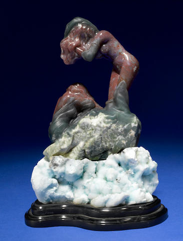 Bloodstone carving of a female nude on hemi morphite base