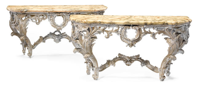 An imposing pair of Italian Rococo style carved silvered wood consoles  second half 19th century