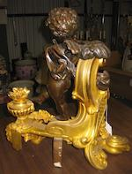 A pair of Louis XV style gilt and patinated bronze figural chenets  <BR />late 19th century