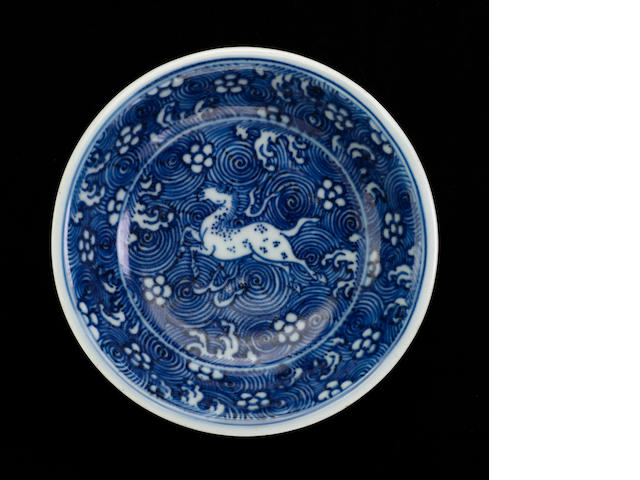 A blue and white horse decorated porcelain saucer dish six character Kangxi mark and period