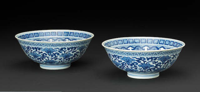 A pair of blue and white porcelain bowls with ruyi cloud collar decoration Daoguang mark and period (chips)