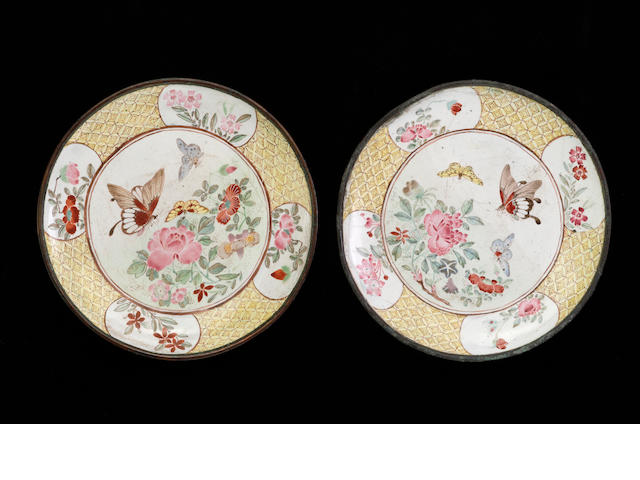 Two small Canton enamel butterfly dishes with four metal feet and famille jaune decoration 18th century