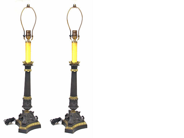 A pair of Charles X style patinated and gilt bronze columnar standards, now as lamps late 19th century