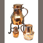 Three copper and iron pitchers late 18th century