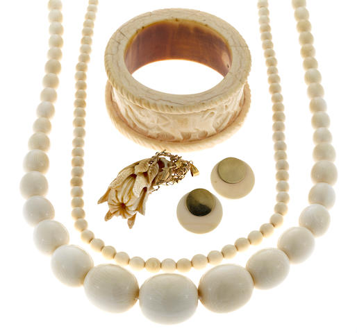 A collection of carved ivory and hardstone jewelry