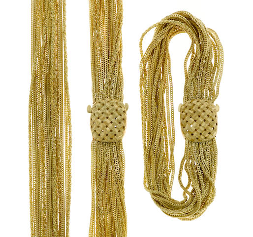 A fourteen karat gold fox-tail and tinsel-chain multi-strand necklace together with matching bracelet