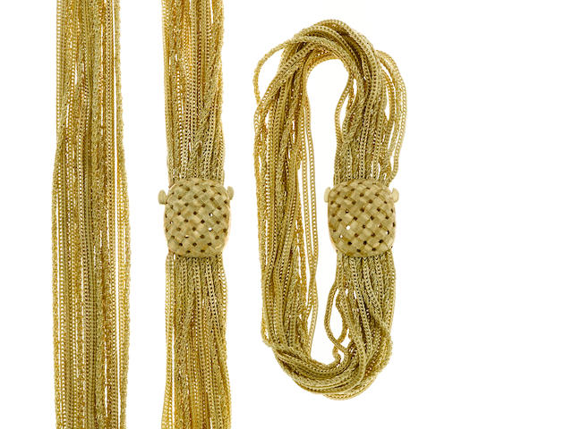 A 14 karat gold multi-strand bracelet weight 37.1g; length 8in together with a A 14 karat gold multi-strand necklace weight 109.9g; length 28in