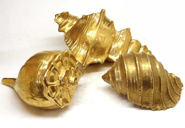 Three large gilt decorated ceramic shells