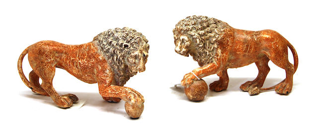 A pair of faux finished ceramic lions