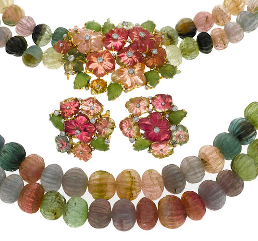 A carved multi-color tourmaline, green-stone and diamond double strand necklace together with a similar pair of earrings