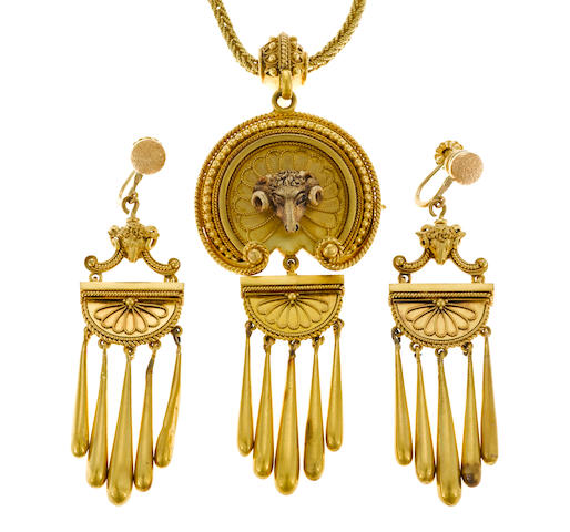 An Etruscan revival eighteen karat gold pendant/brooch with chain together with a matching pair of screwback earrings,