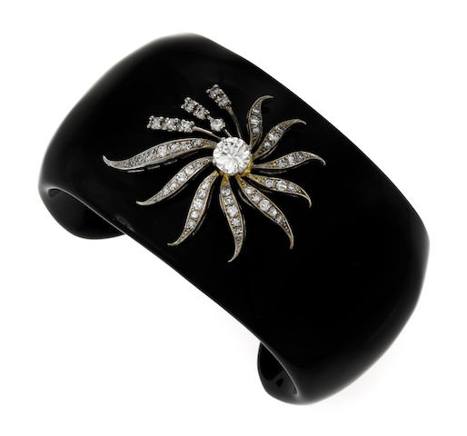A black onyx and diamond stylized flower cuff bracelet