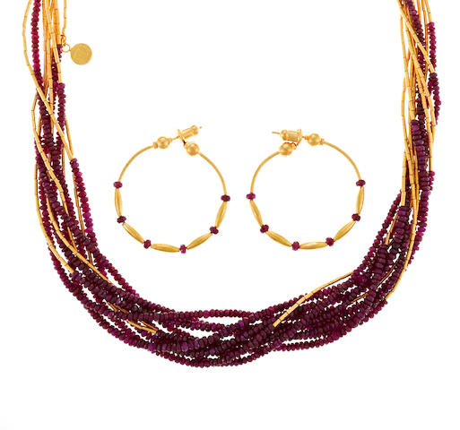 A ruby bead and high karat gold torsade necklace together with a matching pair of hoop earrings, Gurhan