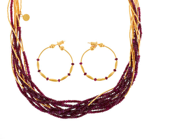 A ruby bead and hi karat gold gold torsade necklace with matching pair of earrings